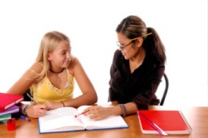 woman tutoring a girl